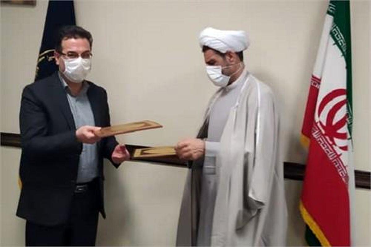 امضای تفاهمنامه همکاری کمیته امداد استان قم و بنیاد شهید و امور ایثارگران